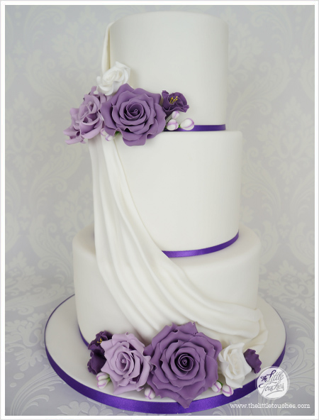 Purple 3 Tier Wedding Cake With Gumpaste Flowers And Drape Cakes