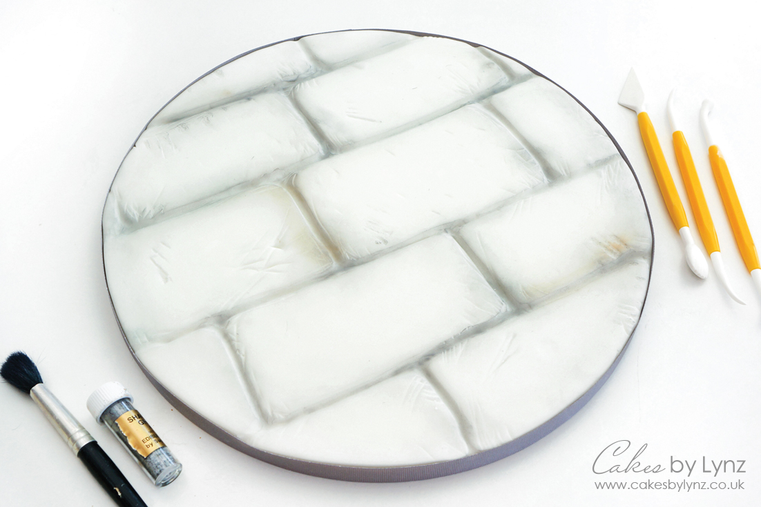 Covering a cake board to look like stone