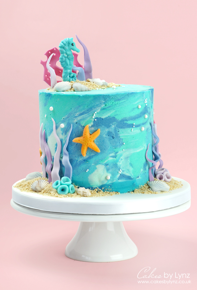 Under the sea seahorse marble buttercream cake