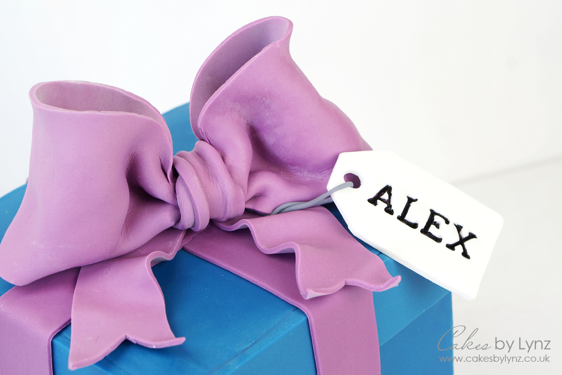 How to make a gumpaste bow cake topper