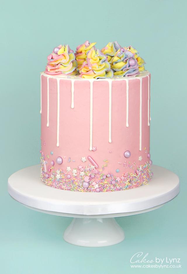 Pastel Rainbow Sprinkle cake with white drip