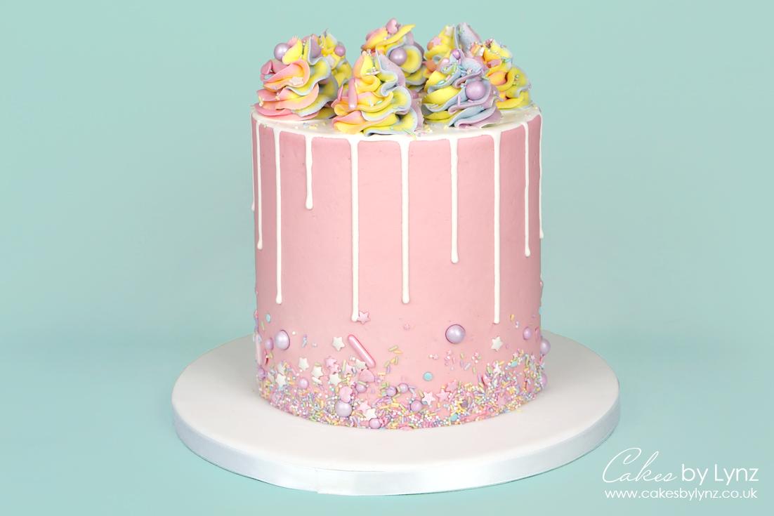 Rainbow Sprinkle white drip cake