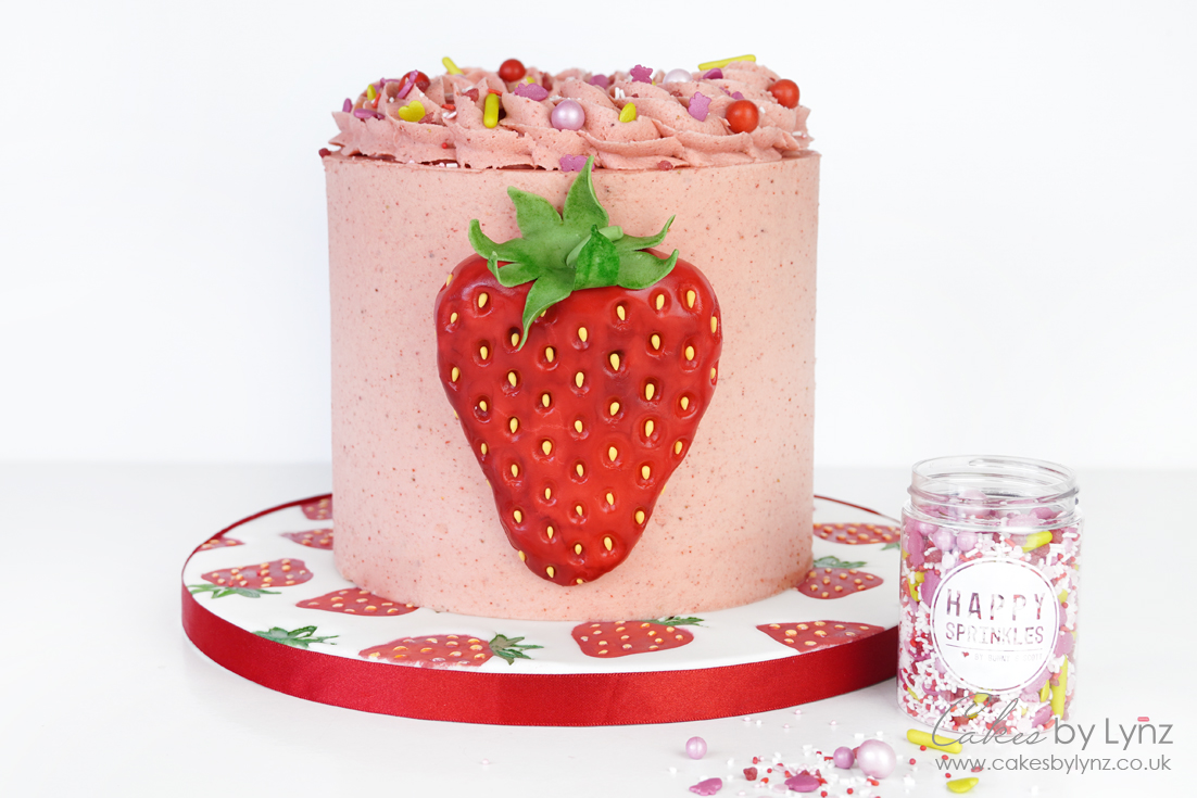 buttercream strawberry cake with sprinkles